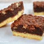 Chocolate Pecan Squares. Melt-in-the-mouth shortbread base with a creamy,bownie like top packed full of pecans! If you love gooey chocolate and pecan pie, you will love these bars. Click the photo for the #chocolatepecanbarsrecipe #chocolatepecanpie #pecanbars