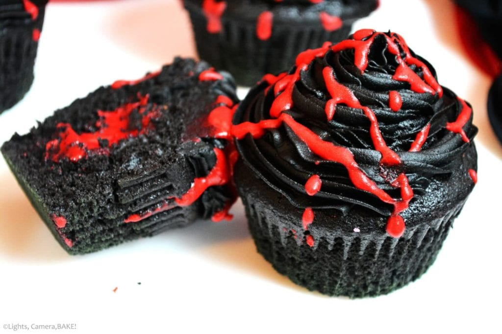 Vampire Cupcakes are a black velvet cupcake with a black, chocolate buttercream, filled with a white chocolate ganache dyed red for the blood filling. Vampire love the night and BLOOD. So fun for Halloween!
