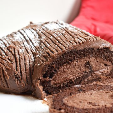 Chocolate Yule Log is a classic Christmas recipe that takes a sponge roll cake and turns it festive! #chocolatespongeroll #yulelog #chocolateyulelog #yulelogcake #fatlessspongerecipe